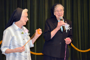 Sisters Inez Wilmering and Julienne Smith, with a combined 140 years as Poor Handmaids,  thank the Sisters for celebrating with them and making this a memorable day.