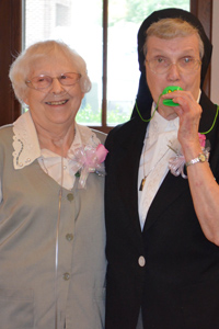 Sisters Patricia Belting and Magdala Oswald enjoyed the noise makers that helped celebrate this special occasion.