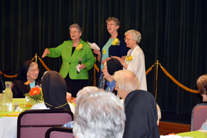 Sisters Coletta Wrasman, Annemarie Kampwerth and Virginia Kampwerth, 50-year jubilarians, sing a song they learned as novices.