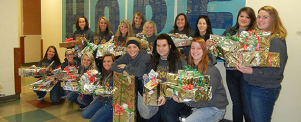 Ancilla Softball Delivers Gifts and Socks to Homeless