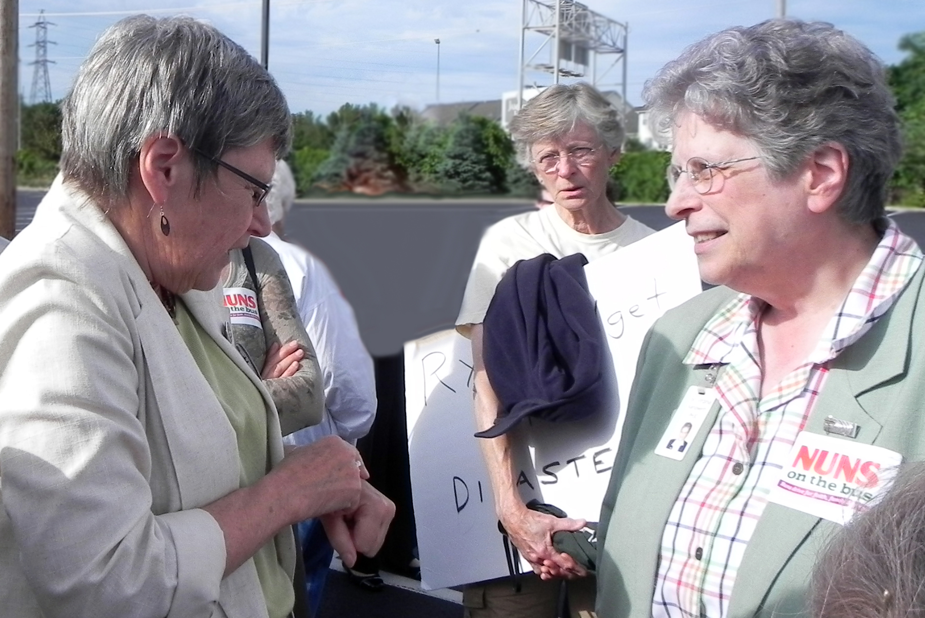 Sister Simone Campbell and Sister Virginia Kampwerth, PHJC visit during the tour stop in South Bend.  Sister Mary Baird, with sign, looks on.